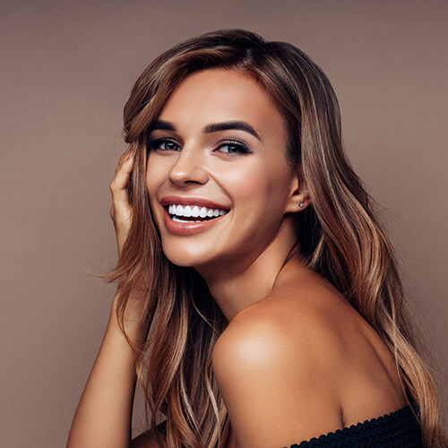 A beautiful young woman with a perfect smile