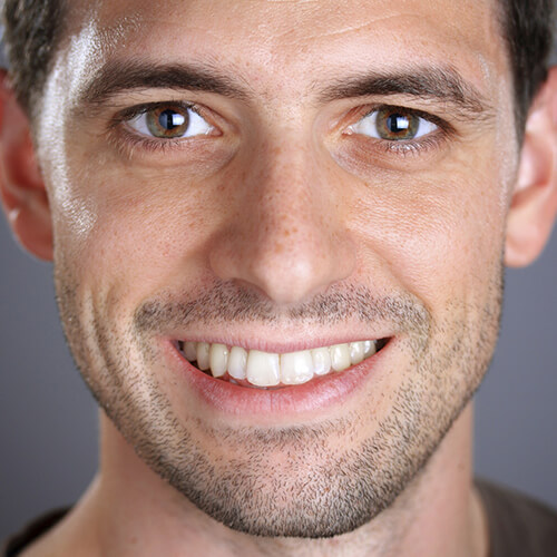 Headshot of a young man with perfect teeth